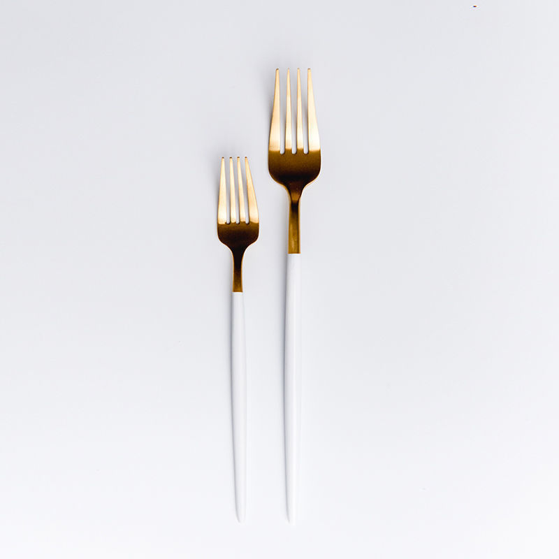 Gold and white cutlery set